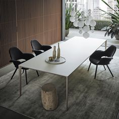 table with palladio structure and bianco latte mat lacquered glass top.