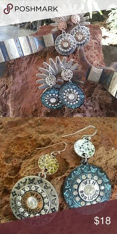 """Bullet Bling Earrings Earrings have a Southwest stamped outer circle followed by a ring of crystals encompassing a bullet like casing with a crystal in the center. Above this is a small hammered disk to complete this fantastic dangle earring. Discs measure 2 """" long.  Available in your choice of Patina or Silver tone. Boutique  Jewelry Earrings"""