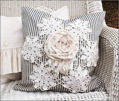 vintage ticking feather/down pillow,  using old lace & rosette on top <3