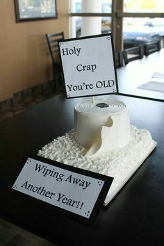 Funny toilet paper cake for a 50th birthday over the hill party