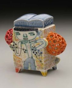 .Kevin Snipes' artwork is a combination of atypical pottery forms and quirky figurative drawings.