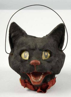 Google Image Result for http://0.tqn.com/d/collectibles/1/0/9/G/4/84cat-lantern.jpg