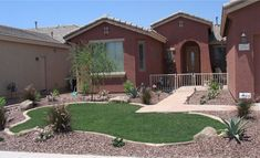 Arizona Tropical landscape design with sod, palm trees, plants ...