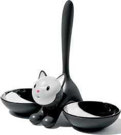 Alessi, our cats get their dinner from this Alessi cat bowl. Salie takes to the right, Moontje always goes for the left side. And, we never trained them to do it, just happens naturally =-)