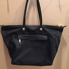 Rebecca Minkoff mini mab nylon tote Nylon tote in good condition, small white spot on the front. Other faint signs of wear. Zip top. Signature studs. Inside and outside zippered pockets. Great for everyday. Rebecca Minkoff Bags Totes
