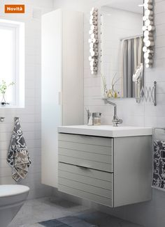 Bathroom with MOLGER trolley and shelves in dark brown and a ...