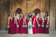 Christmas Winter Barn wedding bridesmaids red & furs.  We love all the lovely winter touches they used for their special day.  From vintage lounge areas with plaid to antlers and greenery to lawn games.  Photos by Trisha Kay Photography.