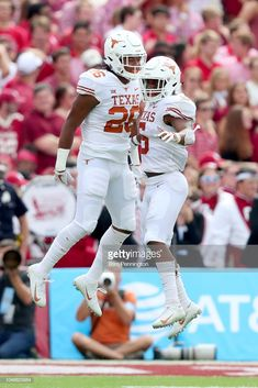 Devin Duvernay of the Texas Longhorns celebrates with Keaontay Ingram of the Texas Longhorns after scoring a touchdown against the Oklahoma Sooners in the first half of the 2018 AT&T Red River. Get premium, high resolution news photos at Getty Images Texas Longhorns Football, College Football Teams, Football Helmets, Team Mascots, Texas Tech Red Raiders, Team Uniforms, Alabama Crimson Tide, Fun Time, American Football