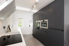 Remo Matte White and Charcoal - Second Nature Larder Unit, Handleless Kitchen, Single Oven, Beautiful Homes, House Beautiful, White Charcoal, Kitchen Collection, Exposed Brick, Cabinet Doors