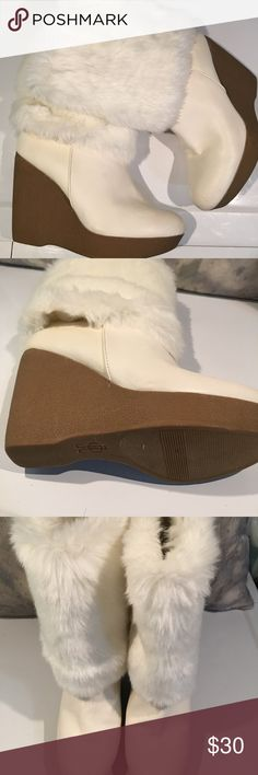 """BEAUTIFUL JLO WINTER WHITE FAUX FUR BOOTS SIZE 6 VERY GENTLY WORN...perhaps 2X.  Jennifer Lopez is a great brand!!!  Heel is too high for my sister.  Heel height is 2.5"""".  We are cleaning out closets and have many designer items that need to find a new closet!!!!  PRICED TO SELL QUICKLY!!!  Bundle bundle bundle for additional savings. Jennifer Lopez Shoes Winter & Rain Boots"""