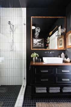 Add dark + moody walls to your bathroom for a luxe feel.