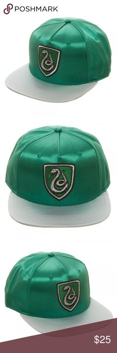 House Slytherin - Harry Potter Shiny Snapback Hat This is an Officially Licensed Harry Potter Hat.  Made of Satin in the house's official colors, it's rather Shiny!  The hat features the House crest / mascot on the front, and also says which house it is on the backside.  It is a Snapback Hat with a flat bill.  Adult size adjustable.  House: Slytherin Size:  Adjustable Age: Intended For Ages 14 and Up Brand: Bioworld  Perfect for any fan of the Harry Potter Series!  Support for the house you…