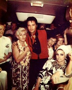 After vacationing in Hawaii, Elvis and Priscilla pose for a photo on the plane back to CA (Elvis would begin filming his Comeback Special 1968).
