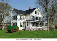 small white homes with black shutters | White House With Black Shutters Stock Photo 50912572 : Shutterstock