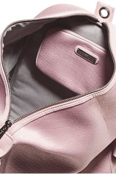 Pastel-pink neoprene Zip fastening along top  Designer color: Smoked Pink/ Gun Metal Weighs approximately 2lbs/ 0.9kgs Imported