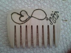 Wooden comb with pyrography pattern