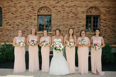 Blush bridesmaids dresses - floor-length gowns with lace illusion neckline {Lightbloom Photography}