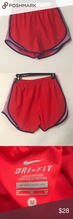 Nike dri fit running shorts. Size M Nike running dry fit shorts in red with purple piping. Inseam is approximately 1.5 inches has built in liner for the underwear. Has a drawstring waist. Nike Shorts