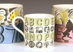 A collection of Wedgwood mugs, designed by Eric Ravilious. From left to right: a George VI coronation cup, circa 1937, an alphabet mug, circa 1937, and an Elizabeth II coronation cup, circa 1953.