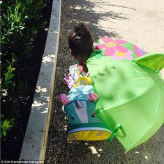 Decision made: The duo finally left the house after coming to a compromise. Nori was seen with her green floral umbrella and unicorn backpack but left the minnie-mouse helmet at home Kim Kardashian Family, Kardashian Photos, Kardashian Jenner, Cute Little Girls, Cute Kids, Kanye West, Vanity Fair, Floral Umbrellas, Minnie Mouse