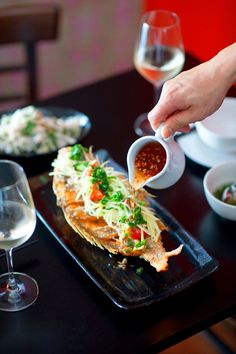 Deep-fried whole snapper with ginger and lime fish sauce (ca chien)