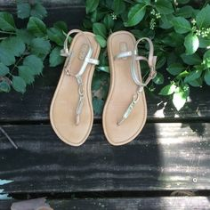 OluKai shiny gold leather sandals Worn once, these beautiful sandals have the OluKai trademark Hawaiian fishhook in gold metal in the center strap. Cushioned leather insole, leather sole with rubber at the heel for better traction. 🎉Summer Staples Host Pick🎉 OluKai Shoes Sandals