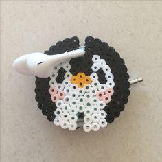 Perler bead earbud holder: penguin