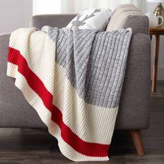 Le rappel des chauds bas de laine, en jeté... trop cocooning. :)