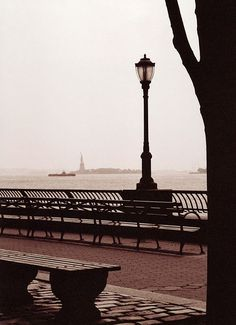 Looking at the Statue of Liberty from Battery Park. A good way to see the Statue if you don't have enough time to go.