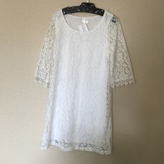 Lace Overlay Dress White lace overlay dress.  3/4 sleeve, fully lined.  I have one Small and one Medium available. Dresses