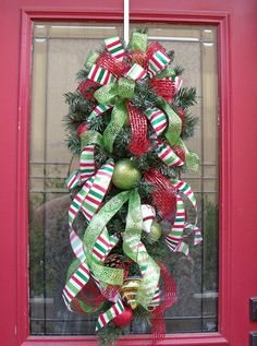 "Christmas Wreath Vertical Swag Ribbon Cascade, no directions, this wreath was sold on Etsy.  32""-33"" Tall 14"" Wide & 7""-8"" Deep"