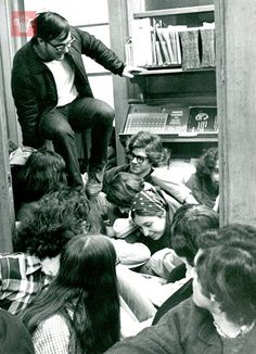 Student climbs over protesting SDS students at Clark University, March 5, 1970, Worcester Massachusetts. Photograph from the Worcester Teleg...