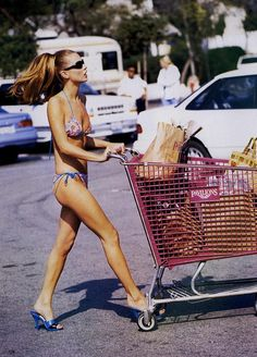 >>> kate moss, groceries in shopping cart | Vogue US, April 1995
