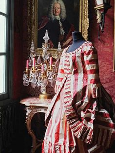 """18th century gown recreated entirely in paper by Belgian artist and sculptor Isabelle de Borchgrave from her large scale installation entitled """"Prêt-à-Papier: The Exquisite Art of Isabelle de Borchgrave"""" at the Hillwood Estate Museum and Gardens in Washington."""