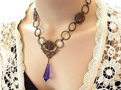 $50  Round circles necklace with Amethyst and Volcano Swarovski crystals. Fabulous necklace and great gift!  www.rachelsjewelrydesigns.com