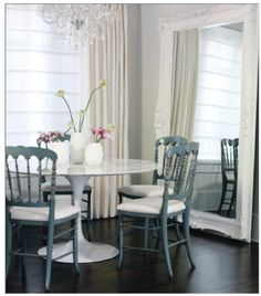 I love the oversized Mirror in this dinning room