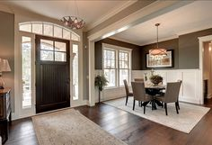 """The entryway is open, stylish and clean, not too busy. The paint color is """"Dawn Mist 3225 by Pratt & Lambert""""."""