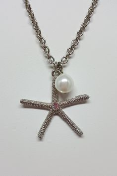 """Charming silver starfish necklace with pearl dangle accent.  Shop: https://www.shoppinwithsailin.com/collections/necklaces/products/16-silver-starfish-necklace-with-pearl-dangle?utm_content=bufferaa7b2&utm_medium=social&utm_source=pinterest.com&utm_campaign=buffer  16"""" Silver chain Cubic Zirconia in center of starfish Matching Pearl Earrings Available Also Available in Gold FREE SHIPPING!!!"""