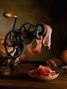 Freshly sliced prosciutto with vintage tool Antipasto, Dark Food Photography, Photography Website, Charcuterie And Cheese Board, Fish And Seafood, Food Presentation, Meat Recipes, Food Pictures, Food Styling