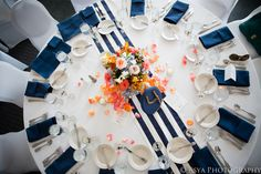 Nautical Themed Table Setting. Maine weddings catered by Foster's Premium Catering, York, Maine. http://www.fosterspremium.com. Fosters Clambakes and Catering authentic New England lobster and clambakes. http://www.fostersclambake.com