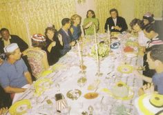 The family at the table in the Joe and Rose Kennedy House, the President at the head of one side of the table.