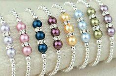 Pulseras de perlas color y bolitas plateadas