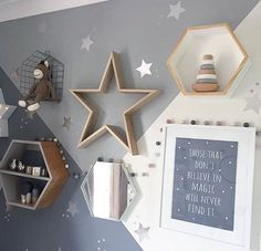 Love this gorgeous grey nursery. Love the geometric paint job and the Hexagon shelves.