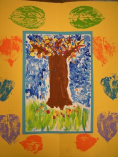 """Monet Fall Trees: 5th grade began by """"studying his paintings and learning about how he used dabs of color without smoothing the paint to fill areas in his paintings. This style of painting is called Impressionism. Students made art like Claude Monet by dabbing colors of paint in this autumn tree painting. They mixed their own secondary colors (orange, green and purple) using the primary colors (red, yellow and blue). For the finishing touch students created a symmetrical leaf print frame."""""""