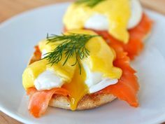 Learn to make eggs benedict with smoked salmon Nova lox, poached eggs, and easy homemade lemony hollandaise sauce. Breakfast, brunch, brinner