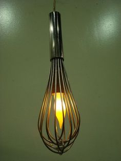 A whisk is actually a perfect utensil which can be used for a kitchen light fixture.