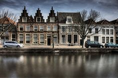 Old facade at a canal in Alkmaar, Netherlands