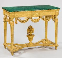 An important pair of late 18th century Piedmontese carved giltwood side tables with dark green malachite tops. 1760