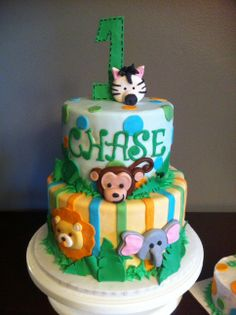 Jungle Themed Kids Cake - Jungle themed first birthday cake covered with fondant and fondant animal figures.