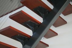 curved gussets under each of the treads plates to support the width of the Jarrah steps